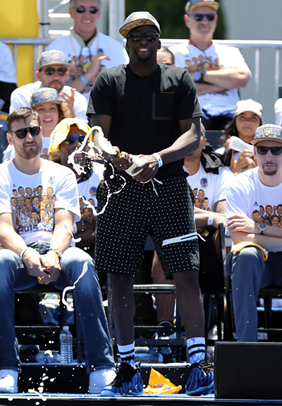 Jun 19, 2015; Oakland, CA, USA; Golden State Warriors forward Draymond Green (23) sprays champagne during the Golden State Warriors 2015 championship celebration at the Henry J. Kaiser Convention Center. Mandatory Credit: Kelley L Cox-USA TODAY Sports