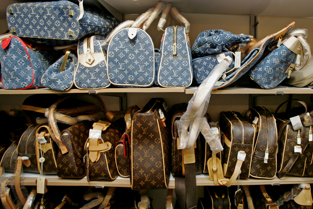 CHINA - DECEMBER 05:  Counterfeit Louis Vuitton bags waited for customers in a counterfeit goods' store that was raided by Hong Kong customs in Hong Kong, China, on December 2, 2005.  (Photo by Lucas Schifres/Bloomberg via Getty Images)