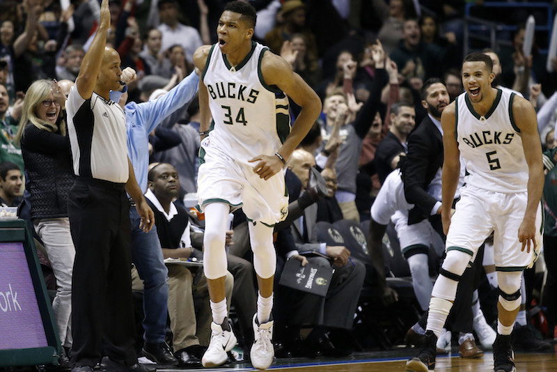 Milwaukee Bucks' Giannis Antetokounmpo reacts after making a three-point basket during overtime of an NBA basketball game against the Atlanta Hawks Friday, Jan. 15, 2016, in Milwaukee. The Bucks won 108-101. (AP Photo/Morry Gash)