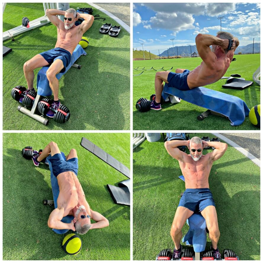 54-year old athlete trains abdominals outdoors to warm-up for leg day.