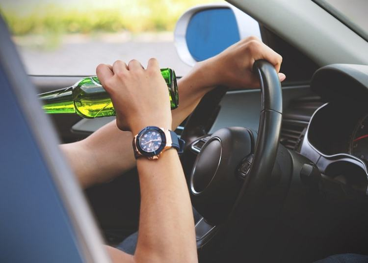 Picture of drinking alcohol while driving
