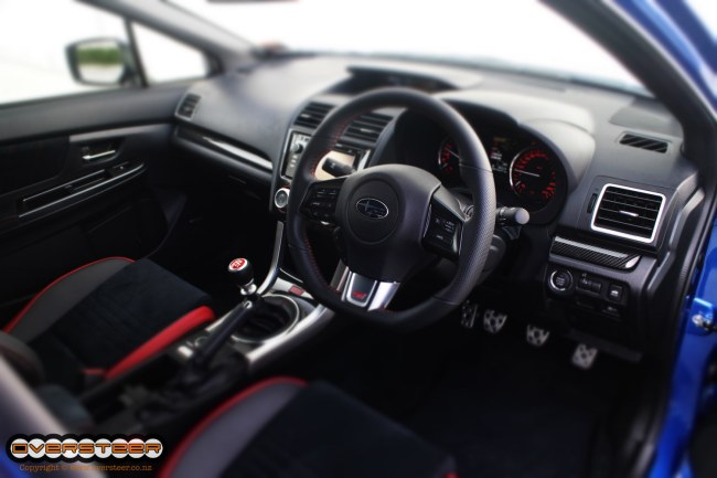 """The interior is the one area that has seen simply massive improvements with the WRX's """"maturity"""" and teh STi version is no different. While it is still nowhere near being up with the Euros, the vast quality strides that have taken place in the WRX (and, by default, the STi) have made it a far more convincing proposition. Previously it was always a case of """"yeah, I just grazed my hand on the rough dash plastic, but jeez this thing is fast!"""" Not anymore though, because while the STi is still blisteringly fast, it will no longer blister your arm if you rub it on the badly made door trims."""