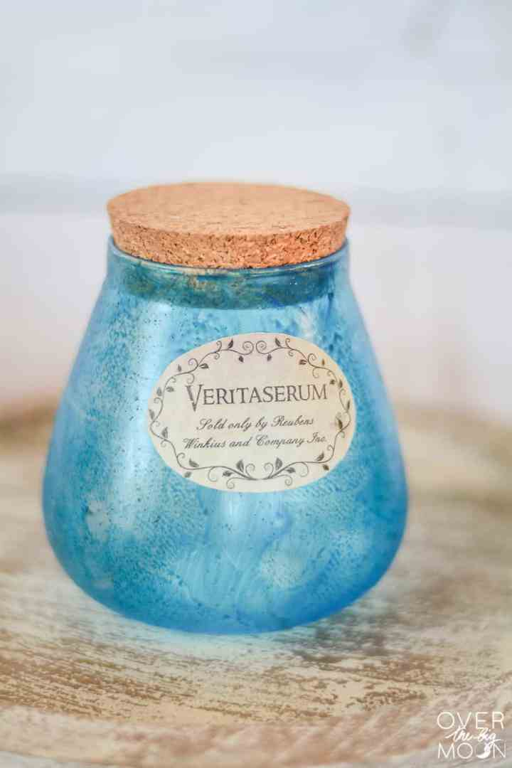 Veritaserum Potion Bottle made to look old by distressing a glass bottle with blue water color.