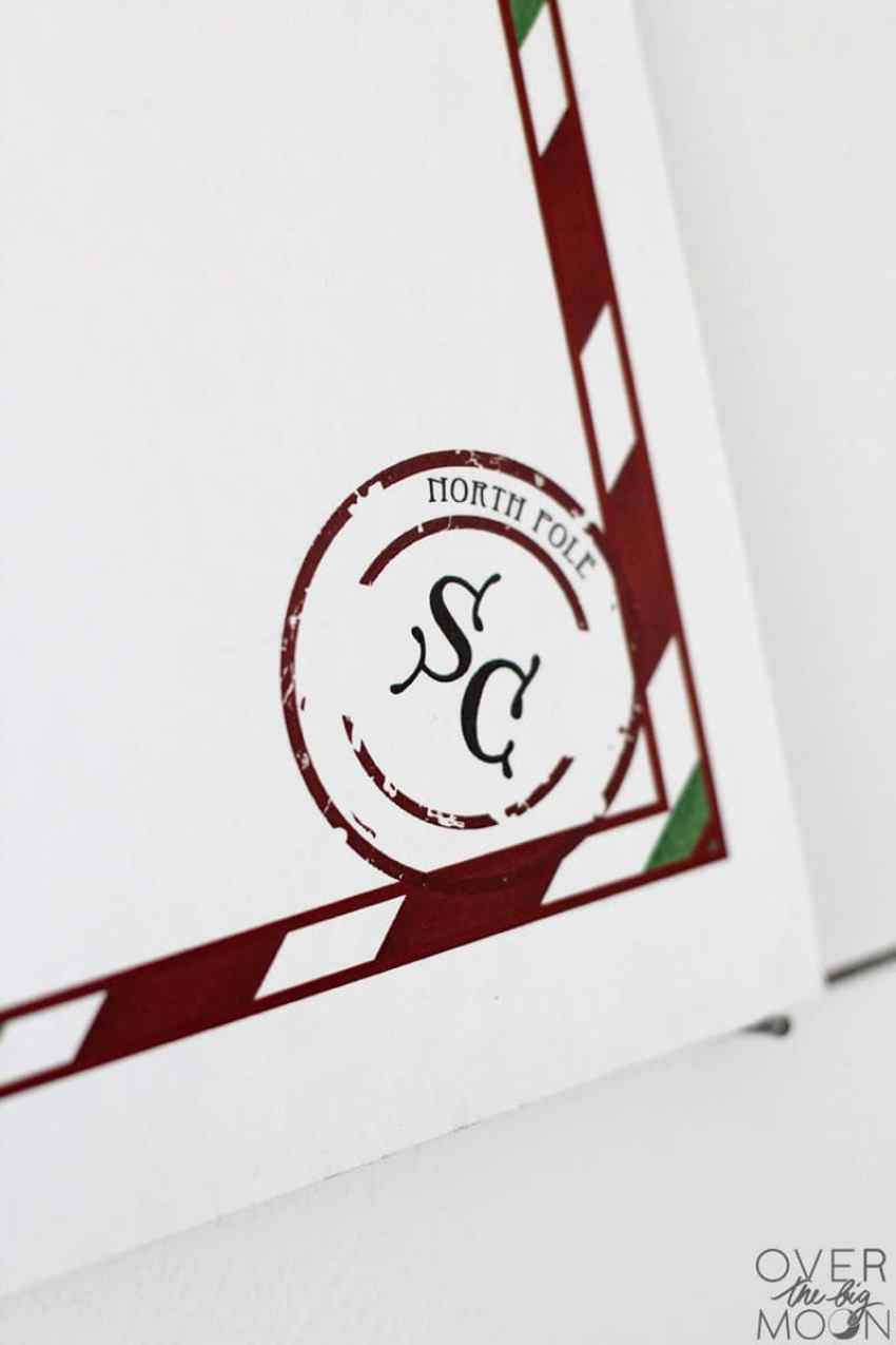 Santa Claus stamp on a free printable North Pole Letterhead! From overthebigmoon.com!