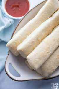Super Easy Homemade Breadsticks -- make these in under an hour! From overthebigmoon.com!