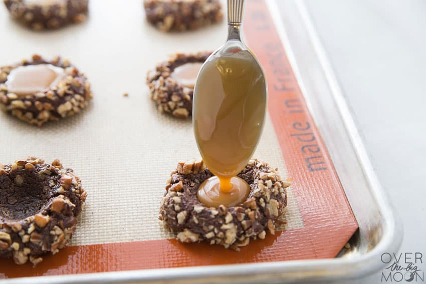 Caramel Filled Chocolate Pecan Cookies - these are the most delicious cookie! From overthebigmoon.com!