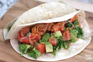 Sloppy Chicken Tacos | Over the Big Moon - A chicken taco with a tomato sauce, with seasonings that make it soooo tasty!!