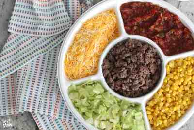 Easy Nacho Bar- this is the perfect lunch for a small group or workplace! Plus, it's easy to prep ahead of time! | www.overthebigmoon.com