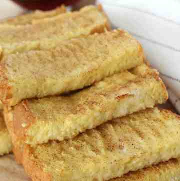 Easy Baked French Toast Sticks - my kids love these! Plus, I'll make them in bulk and freeze little baggies to make for a quick before school breakfast for my kids!   www.overthebigmoon.com