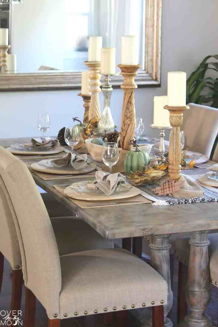 The neutral color palette on this Simple Farmhouse Thanksgiving Table is so elegant! From www.overthebigmoon.com!