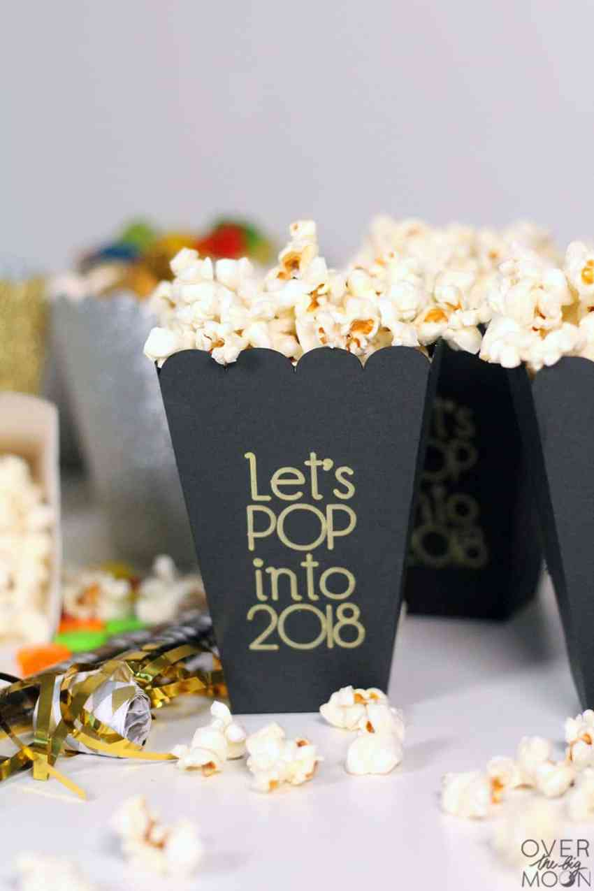 New Years Popcorn Boxes - these boxes were so easy to make with my Cricut, a pen and some cardstock! The year can easily be changed too! From overthebigmoon.com!
