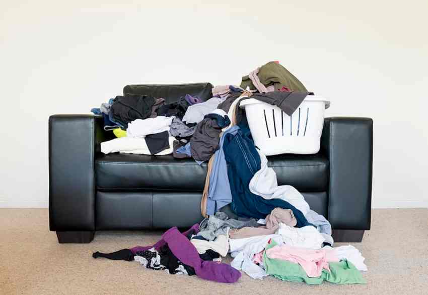 Sick of your couch looking like this? Come check out the perfect Laundry System for Families! From overthebigmoon.com! #laundry #chores