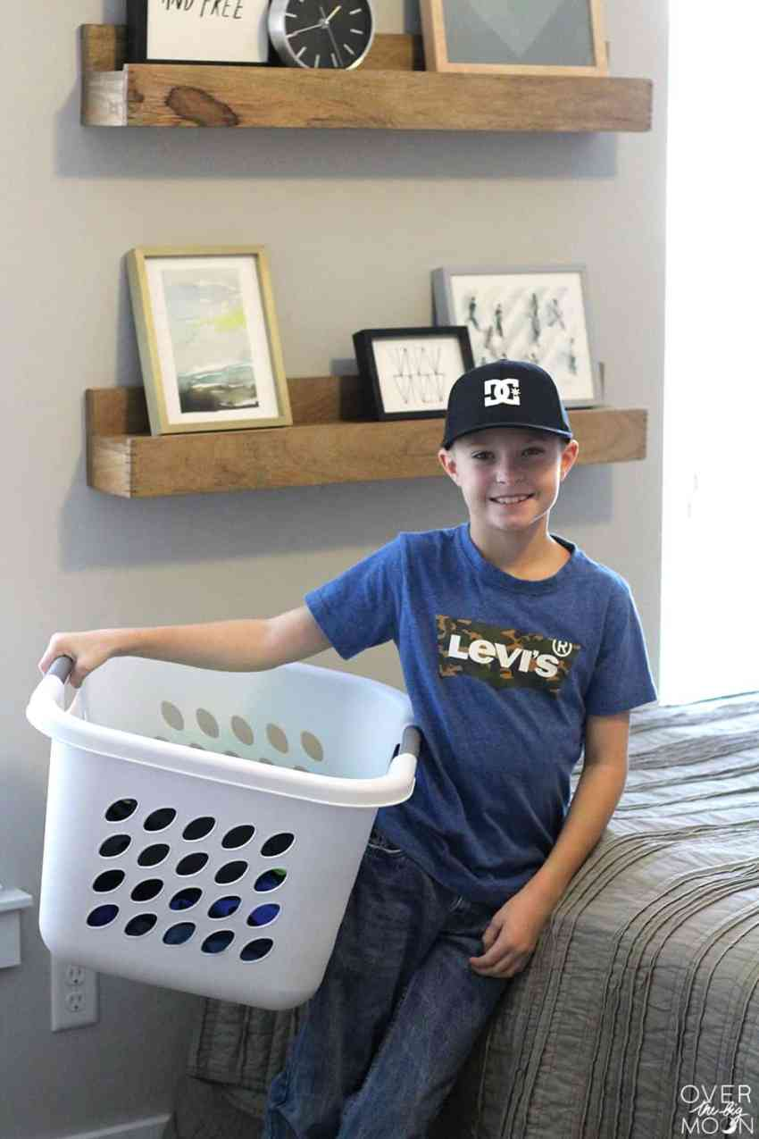 Having Kids Help with Laundry - such a time saver and teaches them life skills! Check out the best Laundry System for Families! From overthebigmoon.com! #chores #laundry