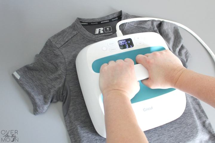 Applying an Iron On Design to a t-shirt using the Cricut EasyPress from overthebigmoon.com!
