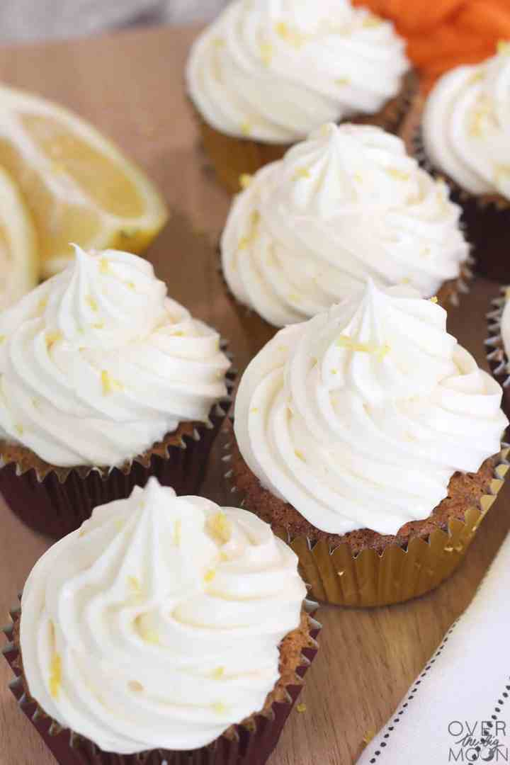 Easter Carrot Cake Cupcakes - the combination of the spiced carrot cake with the lemon cream cheese frosting are mouth watering! A must try recipe! From overthebigmoon.com! #carrotcake