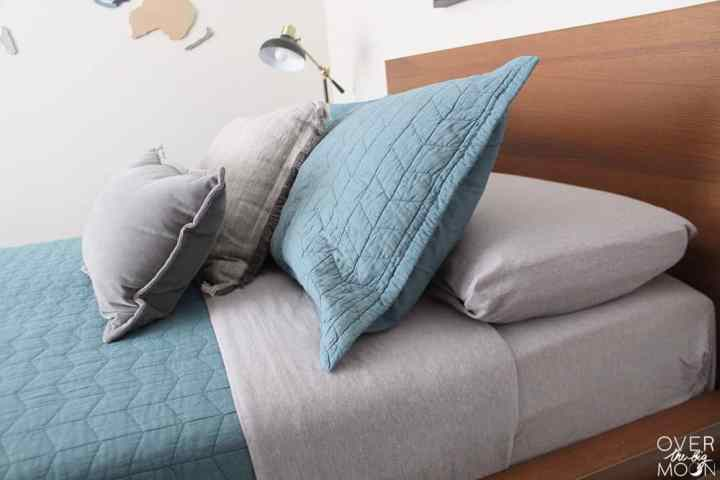 Updated Bedding is one of the major ways to update a bedroom! From overthebigmoon.com!