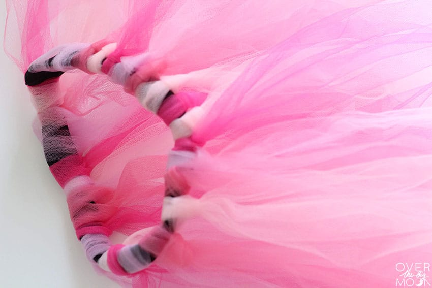Easy Pink Tulle Skirt used to enhance a black dress! From overthebigmoon.com!