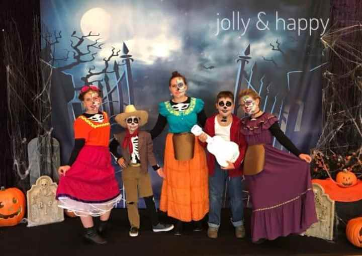 A family dressed up as characters from the movie Coco.