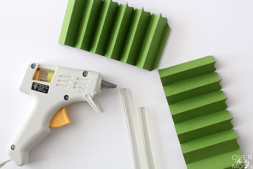 Use hot glue to assemble the cardstock rosettes! From overthebigmoon.com!