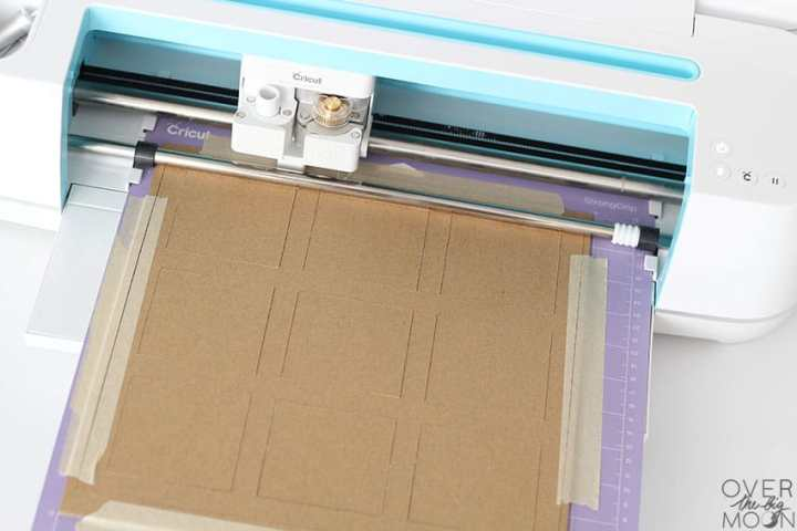 Cricut Maker cutting Heavy Chipboard with the Cricut Knife Blade for a Hanukkah Tic Tac Toe Game! From overthebigmoon.com!