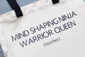 """Infusible Ink transfer onto a tote bag that says 'Mind Shaping Ninja Warrior Queen."""""""