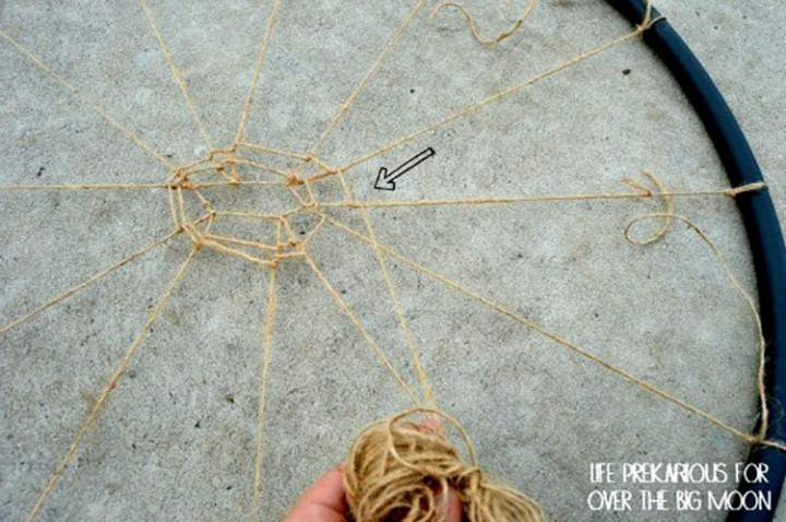 Jute Twine being attached in a Spider Web pattern in a Hula Hoop!