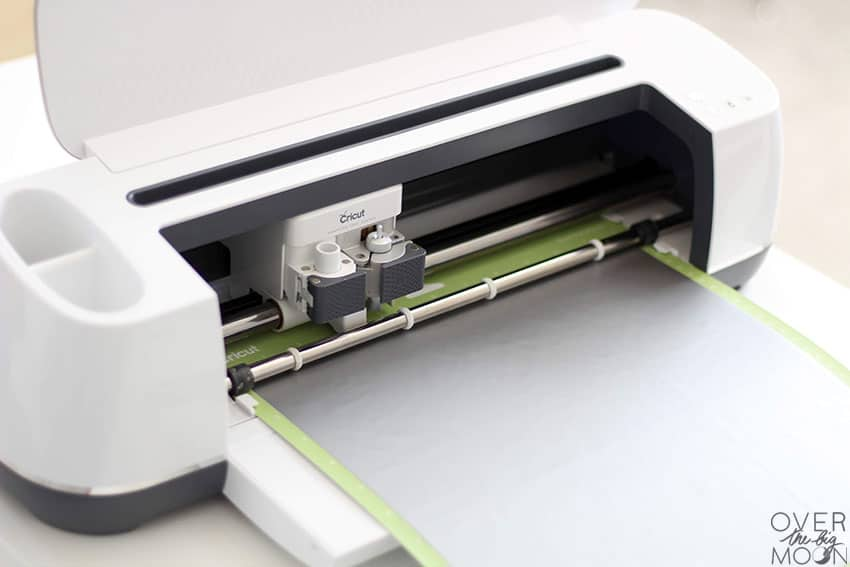 Cricut Maker loaded with a standard mat with vinyl on it.