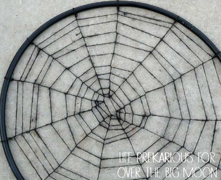 A Hula Hoop Spider Web Spray Painted Black.