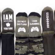 3 pairs of socks with 3 funny sayings added to them using Iron On Vinyl.