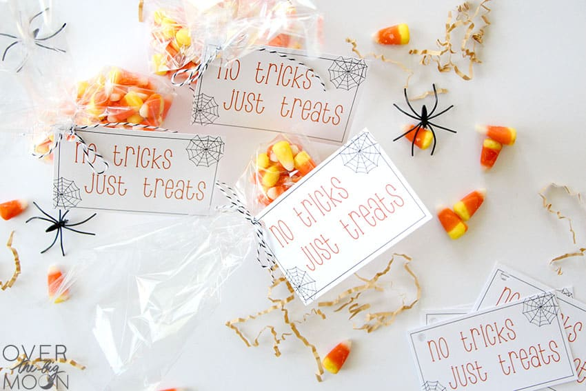 Multiple bags of candy corn, with tags on them that say No Tricks, Just Treats.