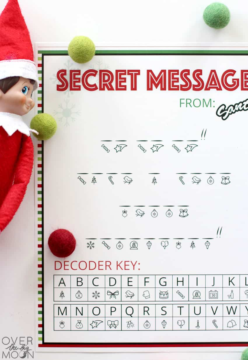 The printed Secret Message from Santa printable ready to decode with the Elf off to the left!