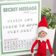 Secret Message from Santa Printable with the Elf sitting off to the side.