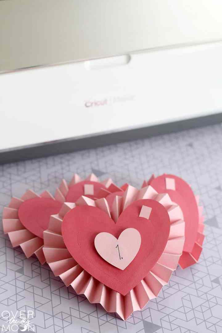 3 Rosette Hearts in front of a Cricut Maker.