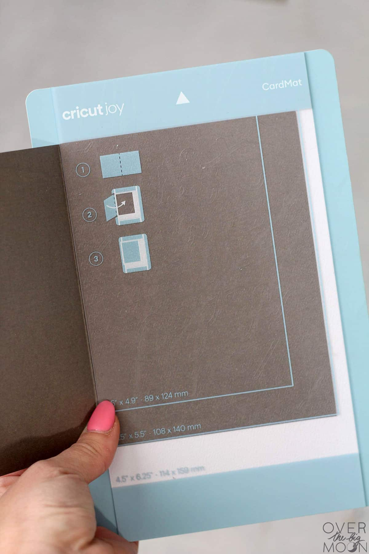Cricut Joy Card Mat with a gray card inserted into it.