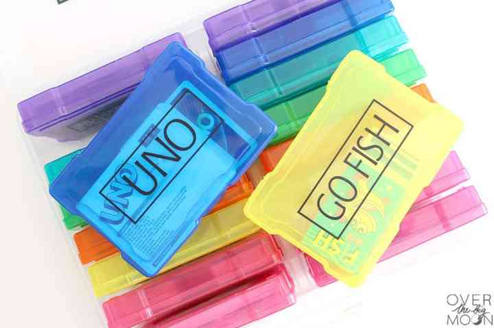 Color card organizer that was made for card games. Two cases are laying on top that say Uno and Go Fish!