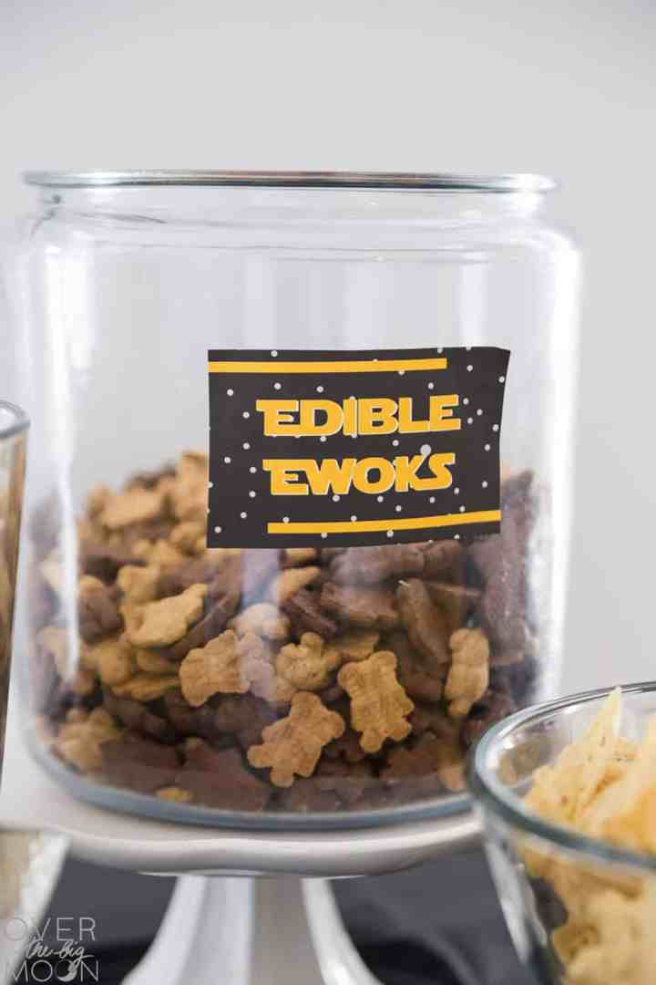 "A glass jar with Teddy Grahams in it, labeled ""Edible Ewoks""."