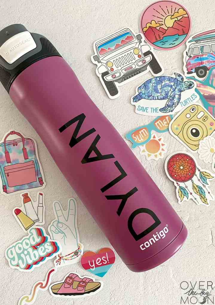Purple Tumbler with the name Dylan on it with sticker around the tumbler.
