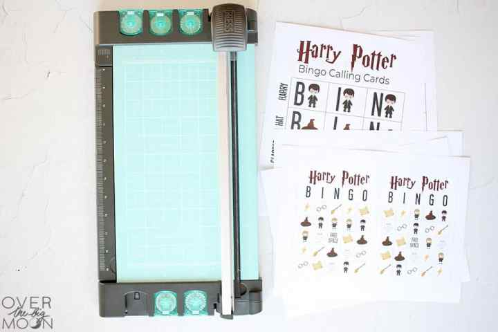 Harry Potter Bingo Cards and calling cards sitting next to a paper cutter.