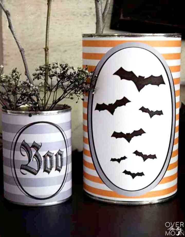 Up close look of two tin cans wrapped in Halloween Tin Can Wrappers.