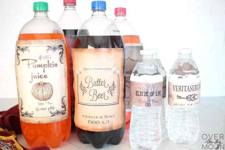 2 Liters and Water bottles with Harry Potter Drink lables on them for a Harry Potter party.