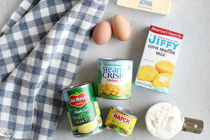 All the ingredients needed to make a corn casserole: Jiffy Muffin Mix, cans of corn, eggs, butter sour cream.