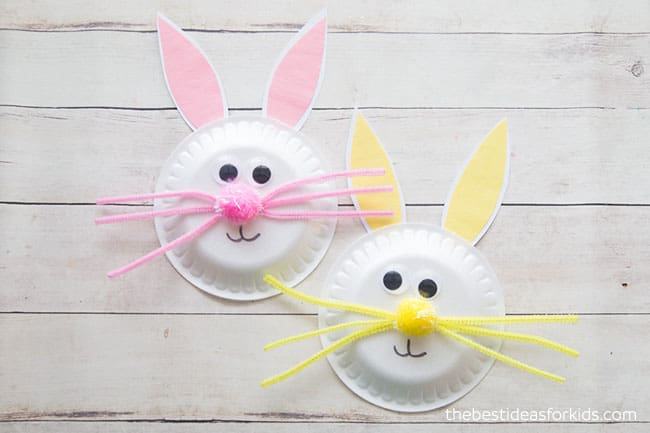 Two paper plates turned into Easter Bunnies using colored paper, poof balls, craft eyes and markers.