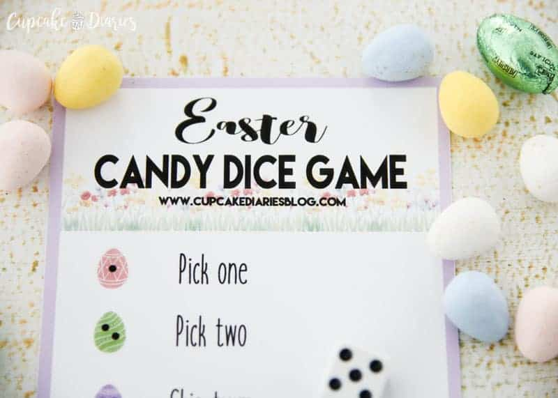 A printed Easter Candy Dice Game with easter candy laying around the printed game.