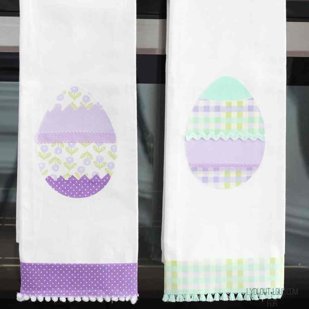 Two dish towels with Easter Eggs on them in purple and green.