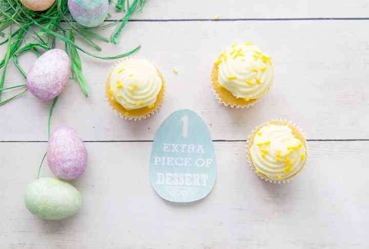 """A blue printed egg that says """"1 Extra Piece of Dessert"""". Around it is 3 cupcakes."""