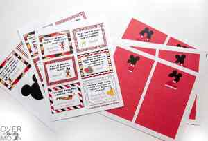 Disney Joke Cards and red printed envelopes printed on sheets of paper.