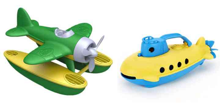 Two pool toys -- on the left is a green and yellow water plane and on the right is a blue and yellow submarine.