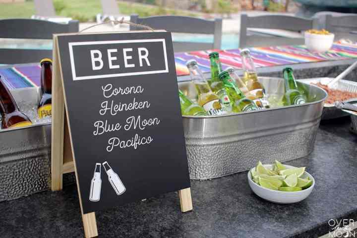 A beer menu with silver tubs on bottles of beer.