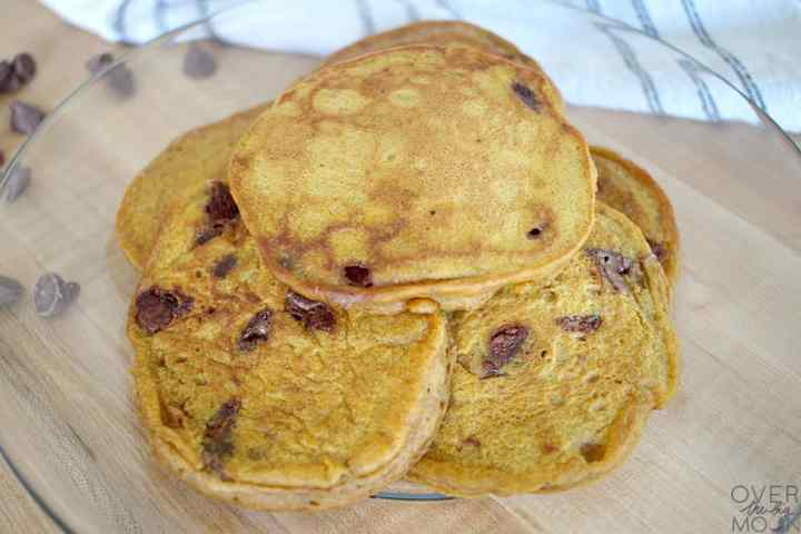 A plate with a half dozen or so Pumpkin Chocolate Chip Pancakes.