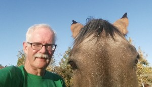 Old man and horse facing camera